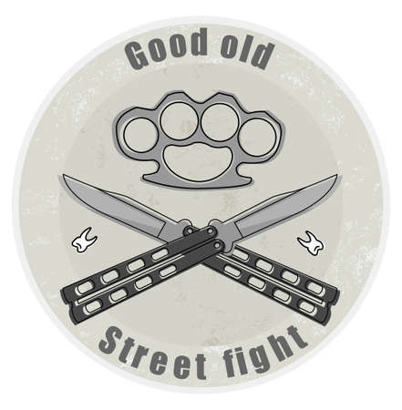 Crossed butterfly knifes with steel brass knuckle and broken teeth emblem Vector