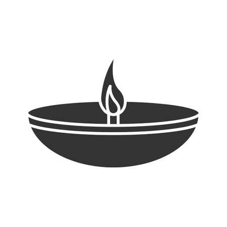 Islamic oil lamp glyph icon. Diya. Islamic culture. Burning bowl oil lamp. Silhouette symbol. Negative space. Vector isolated illustration