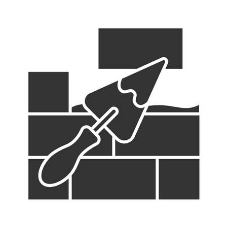 Brick wall with triangular shovel glyph icon. Putty knife, spatula. Cement solution. Silhouette symbol. Negative space. Vector isolated illustration