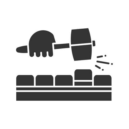 Pavement bricks with lump hammer glyph icon. Builder's hand. Silhouette symbol. Negative space. Vector isolated illustration