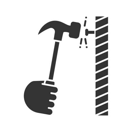 Hand hammering nail glyph icon. Silhouette symbol. Builder's hand. Negative space. Vector isolated illustration