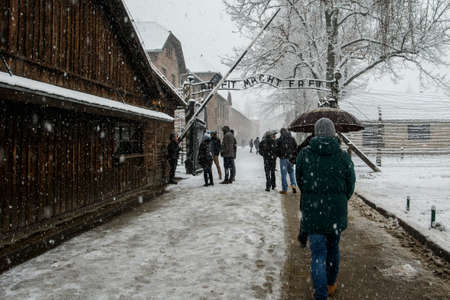 Auschwitz, Lesser Poland  Poland - Feb 04 2018: Auschwitz Birkenau, Nazi concentration and extermination camp, visitors at camp entrance.