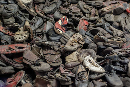 Auschwitz, Lesser Poland  Poland - Feb 04 2018: Auschwitz Birkenau, Nazi concentration and extermination camp. Pile of shoes from the victims of holocaust.