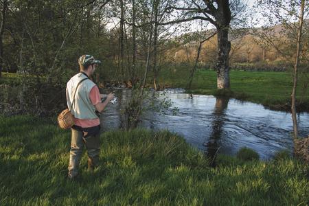 sport fisherman in river, Galicia, Spain.