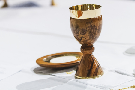 Wood chalice and pyx.