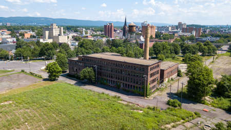 Aerial view of the skyline in Wilkes-Barre, Pennsylvania. A long-abandoned factory is in the foreground.