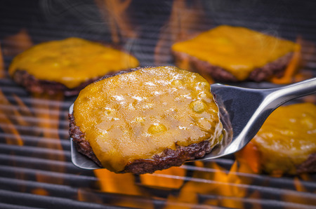 cheeseburgers: Cheeseburgers on a hot Flaming Grill