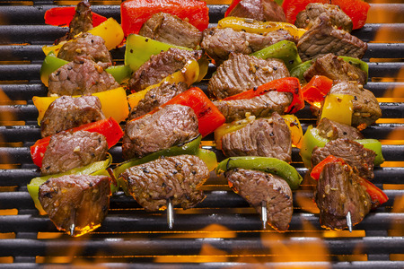 barbequing: Kabobs on a Hot Flaming Barbecue Grill