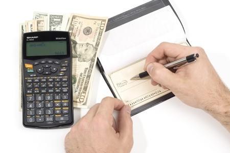 A person writting a check