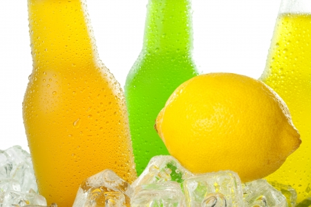 Close up of wet bottles with cold beverage in ice  Stock fotó