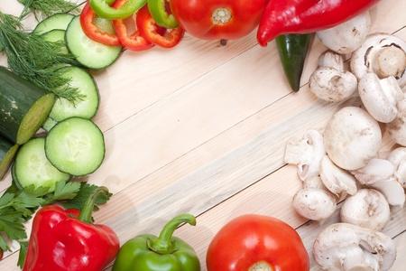 Heap of different veggies on wooden board Zdjęcie Seryjne