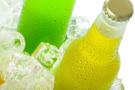 Close up of wet bottles with cold beverage in ice  Imagens