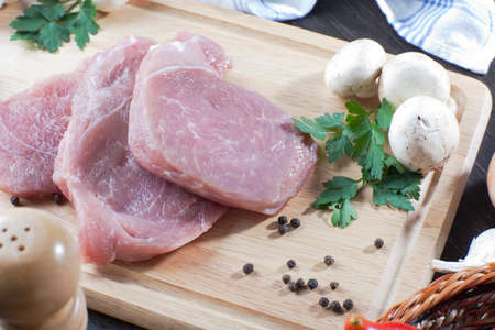Heap of fresh raw ready for cooking pork meat  Stock Photo