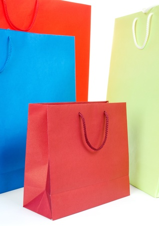 Different color and size colorful bags on white background
