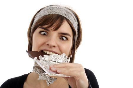 hormone: Stock Photography von h�bschen jungen Frau essen Schokolade  Lizenzfreie Bilder