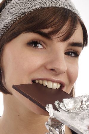 expressive mood: Stock Photography of pretty young woman eating chocolate