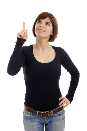 expressional: Stock photo of a pretty young woman pointing up