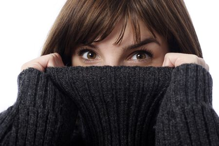 Stock photo of pretty young woman holding sweater collar, close-up photo