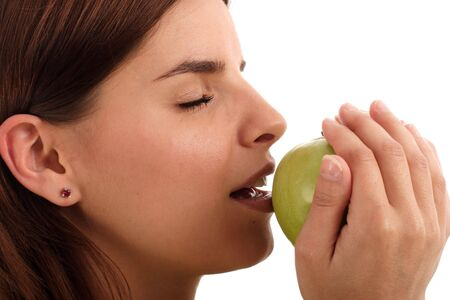 fare: Young woman holding green apple