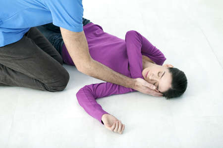 First Aid Techniques :Placing The Victim In The Recovery Position.Step 2 :Take The VictimS Other Arm,Put The Back Of Their Hand Against Their Ear.Keep The VictimS Hand Pressed Against Their Ear LANG_EVOIMAGES
