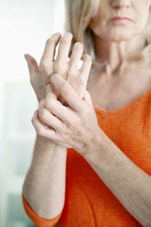 Elderly Person With Painful Hand LANG_EVOIMAGES
