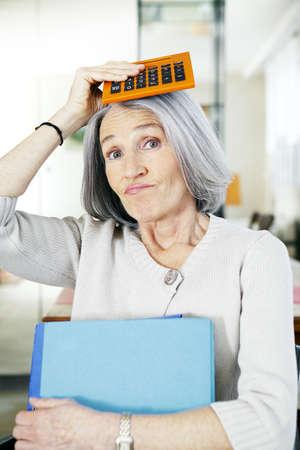 Elderly Person Doing Paperwork LANG_EVOIMAGES