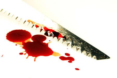 violence in the workplace: Sierra de calar con sangre Foto de archivo