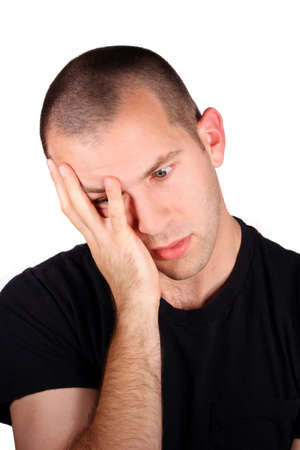 A handsome man with a disappointed expression in front of a white background. Stock Photo