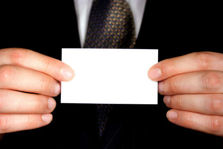 business card in hand: A businessman holding up a blank businesscard - add your own text. Stock Photo