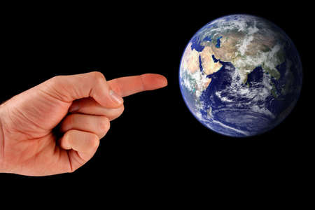 A mans finger pointing at the earth. Earth image courtesy of NASA - Visible Earth: http:visibleearth.nasa.gov
