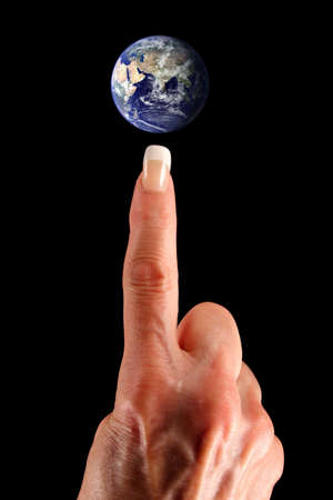 The whole world is at her fingertip. Earth image courtesy of NASA - Visible Earth: http:visibleearth.nasa.gov Stock Photo
