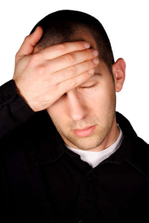 A man with a headache in front of a white background. Stock Photo