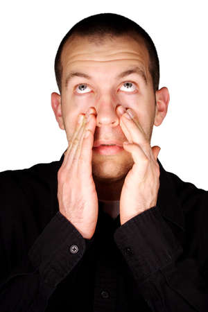 A man with sinus pressure in front of a white background.