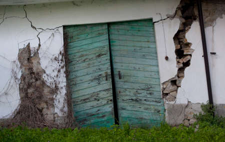 landslide: Ruined door caused by a landslide. Piedmont, Italy.