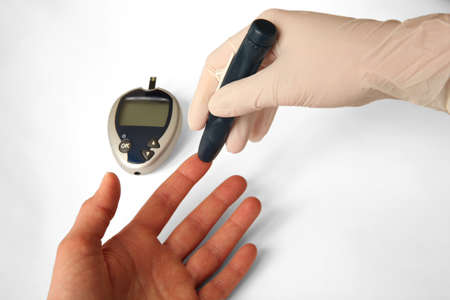 regulate: Testing for the level of blood sugar.  Equipment used to regulate diabetes. Stock Photo