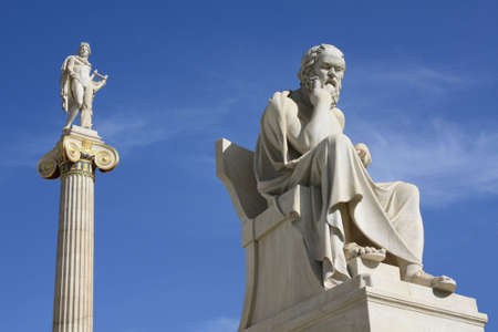 Neoclassical statues of Socrates and Apollo in front of the Academy of Athens, Greece. Stock Photo