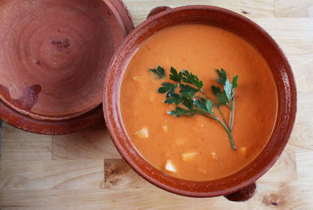 Andalusian gazpacho in a clay pot. It is a cold Spanish tomato-based raw vegetable soup.