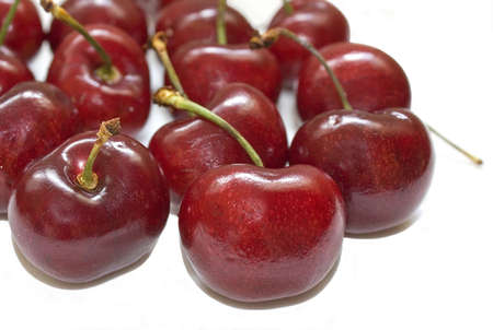 Several cherries isolated over a white background