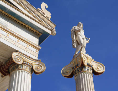Neoclassical statue of ancient Greek good, Apollo, outside Academy of Athens, Greece. Apollo was the god of light and the sun, truth and prophecy, archery, medicine and healing, music, poetry and the arts.  Stock Photo