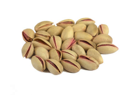 Some pistachios isolated over white. photo