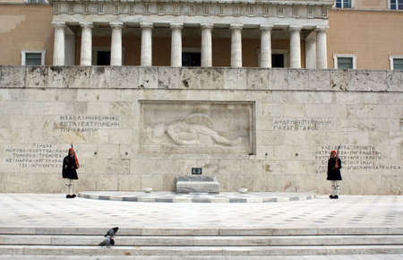 Athens, Greece - April 21, 2009: Evzones (palace ceremonial guards) in front of the Unknown Soldier's Tomb at the Greek Parliament Building in Athens, opposite Syntagma Square. Evzones guard the Tomb of the Unknown Soldier, the Hellenic Parliament and the Stock Photo - 6887643