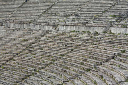 Close up of stone seats in Greek ancient theatre of Epidauros. Stock Photo