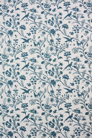 Victorian Wallpaper depicting floral motives and birds.