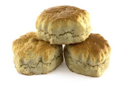 Three plain scones over a white background.