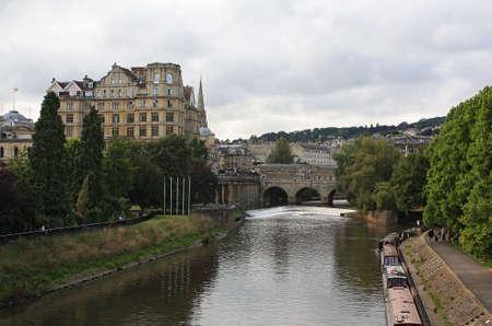 View of Bath and River Avon: Pultney Bridge, the Empire, riverside walk. photo