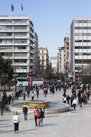 Athens, Greece - February 25, 2010: Athenians walking in Syntagma Square (Constitution Square) opposite Hellenic Parliament.