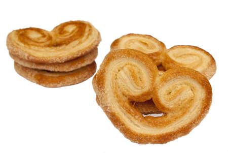 Heart shaped saporelly, sweet puff pastry, isolated over a white background. photo