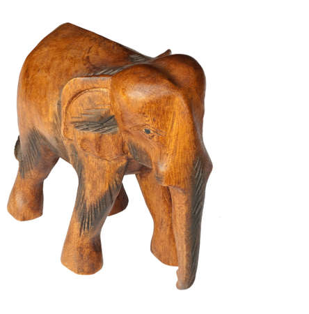Wooden elephant sculpture isolated over a white background. Stock Photo - 7857058