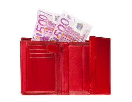 Red wallet with two five-hundred-euro banknotes isolated over a white background.