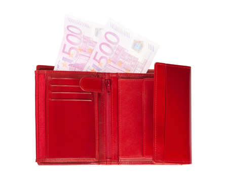 Red wallet with disappearing five-hundred-euro banknotes isolated over a white background. photo